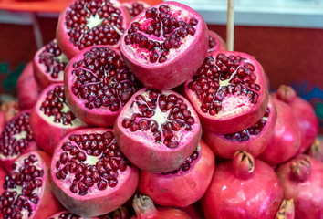 Juicy red pomegranate on the shop window.