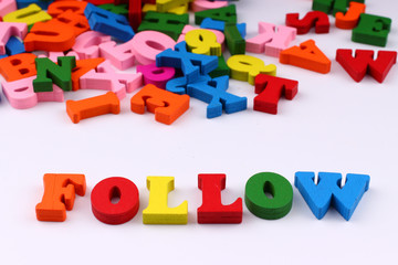 The word follow with colored letters