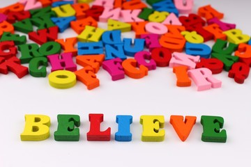The word believe with colored letters