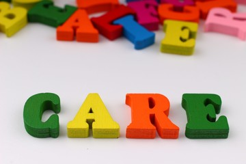 The word care with colored letters