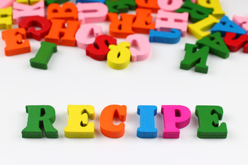 The word recipe with colored letters