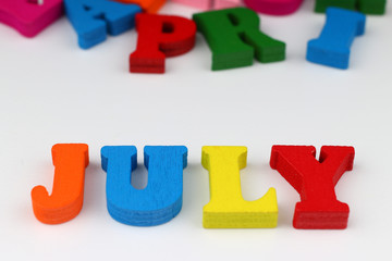 The word july with colored letters