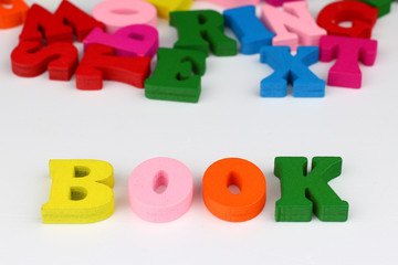 The word book with colored letters