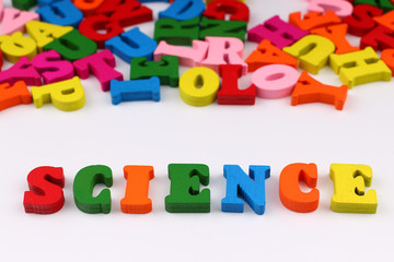 The word science with colored letters