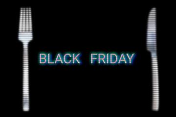 Black friday food concept. Online food sales on website market. Knife, fork and title black friday with glitch effect. Black background.
