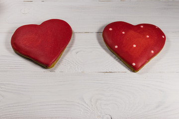 Heart shaped cookies for valentine day on white wooden table. Top view