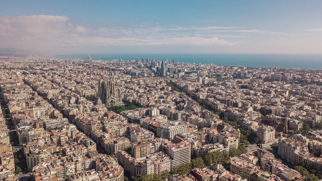 Cityscape of Barcelona at sunny day. Aerial view
