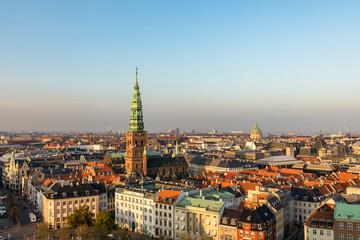 Copenhagen skyline in evening light. Copenhagen old town and copper spiel of Nikolaj Contemporary Art Center.