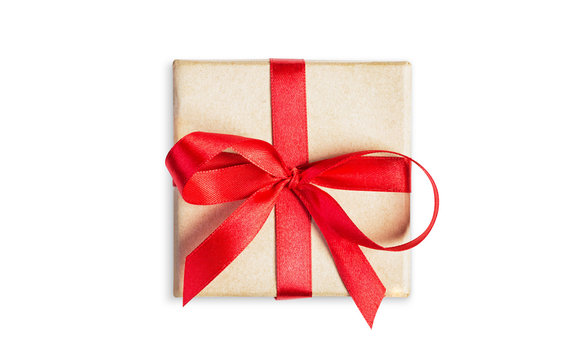 Small square gift box tied with red ribbon isolated on white background, top view