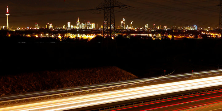 Cars on highway A5 passing by the skyline of Frankfurt