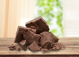 Dark chocolate blocks and bieces isolated on