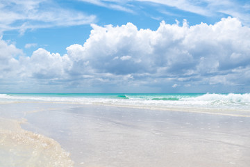 beach at the ocean on the background of beautiful clouds and the sun