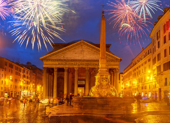 Fototapete - view of ancient Pantheon church in Rome illuminated at blue night with fireworks, Italy