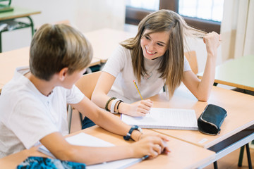 Couple young students studying at school