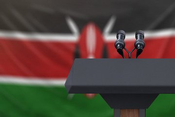 Podium lectern with two microphones and Kenya flag in background