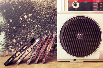 Old audio cassettes with vintage speaker