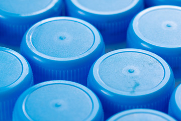Close up of blue drinks bottle tops