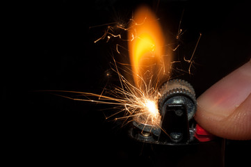 The moment of ignition and spark of an old lighter