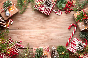 Wall Mural - Gift boxes with fir branches on wooden background