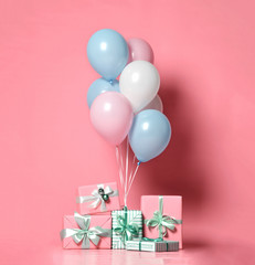 Helium inflatable latex pastel color light blue pink white balloons and present gifts  background