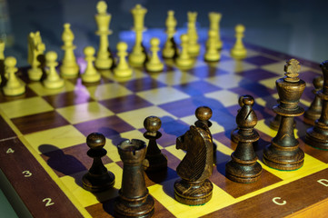 background. wooden chess pieces (white / black) placed on a chessboard