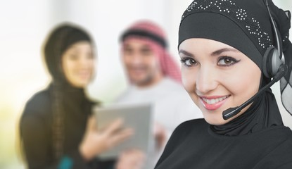 Beautiful middle eastern businesswoman with headphones