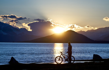 Cyclist silhouette of the lake Hoton-nuur