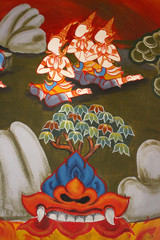 Detail from a painting of a a group of Buddhists praying behind a creature from which a colorful tree is growing, found on an ancient temple wall in Thailand