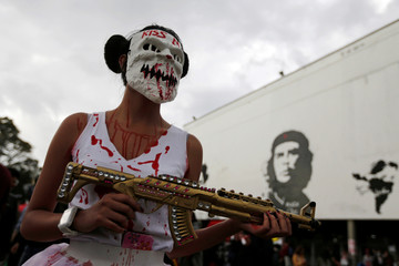 A student participates in a protest to demand more resources from the government to finance public education in Bogota