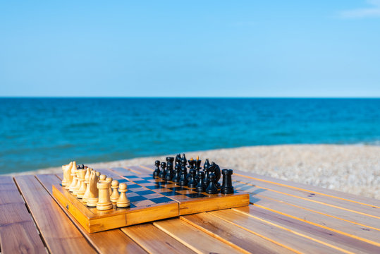 Chess board on the table by the sea