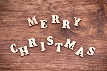 Inscription Merry Christmas on rustic board, festive time concept