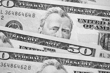USD fifty dollar bills background close up. Black and white