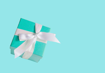 turquoise gift box on a blue background