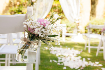 floral decoration at a wedding ceremony outdoors