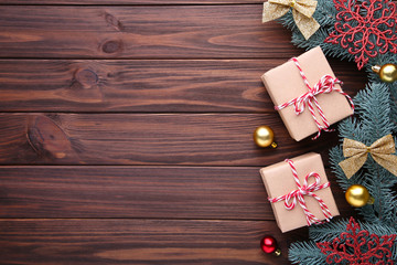 Christmas gifts presents with decorations on a brown background.