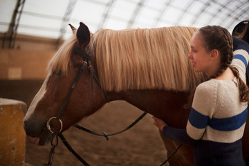 Horse and teen girl - best friends. Learning equestrian