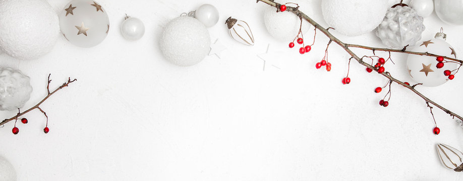 Christmas white wood background with bauble and red berries