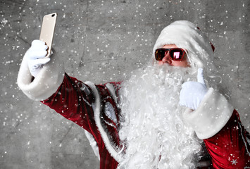 Santa Claus make selfie with mobile cellphone. New year and Merry Christmas