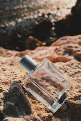 male Perfume and yellow rocks on the beach