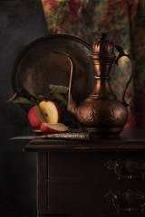 Oriental stilllife with copper jug (kumgan) and apple