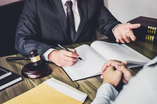 Businessman and Male lawyer or judge consult having team meeting with client, Law and Legal services concept