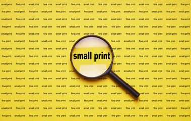 small print enlarged with magnifying glass magnifier loupe, business concept