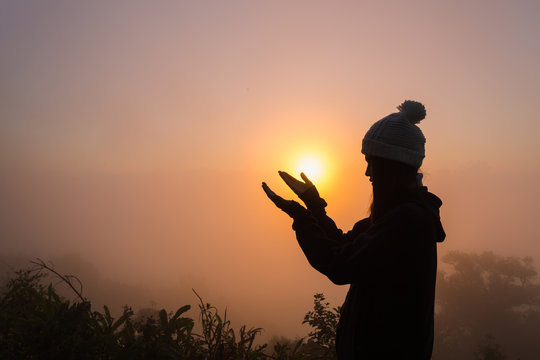 Silhouette of woman hands praying to god . Woman Pray for god blessing to wishing have a better life. Christian life crisis prayer to god.