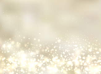 Abstract luxury golden light glittering blurred background.