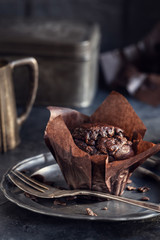 Chocolate muffin on vintage plate background. Shallow depth of field.