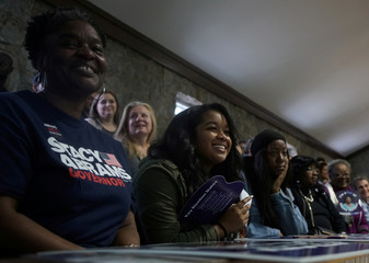 Stacey Abrams supporters smile as they listen as the democratic gubernatorial candidate for Georgia speaks ahead of the midterm elections in Newnan, Georgia