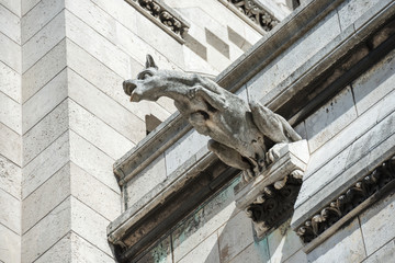Gargoyle statue on Basilica Coeur Sacre on Montmartre in Paris