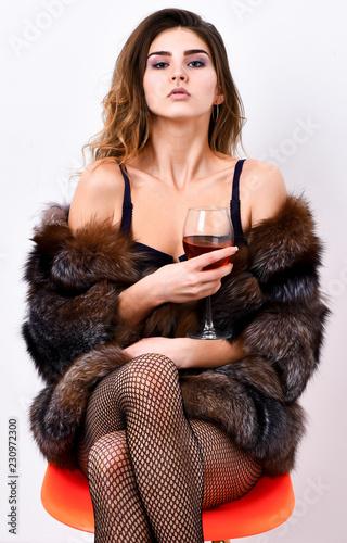 13fcf63955c Woman seductive model enjoy wine wear luxury fur and elite lingerie. Girl  you dream about. Fashion lady enjoy luxury lifestyle. Luxury life concept.
