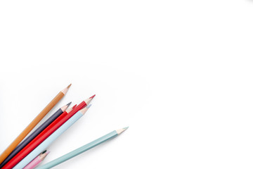 Color pencils on white background. Education, school concept. Close up.Seamless colored pensils