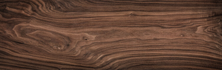 Super long walnut planks texture background.Dark tone walnut texture,Walnut natural texture, texture elements.